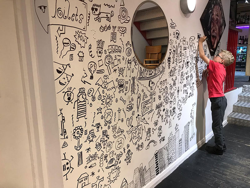 kid told not to doodle in class gets hired by local restaurant to decorate their walls 24 Kid Told Not to Doodle in Class Gets Hired by Local Restaurant to Decorate Their Walls