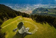 Massive Biodegradable Artwork of Hope Appears Atop Swiss Hillside