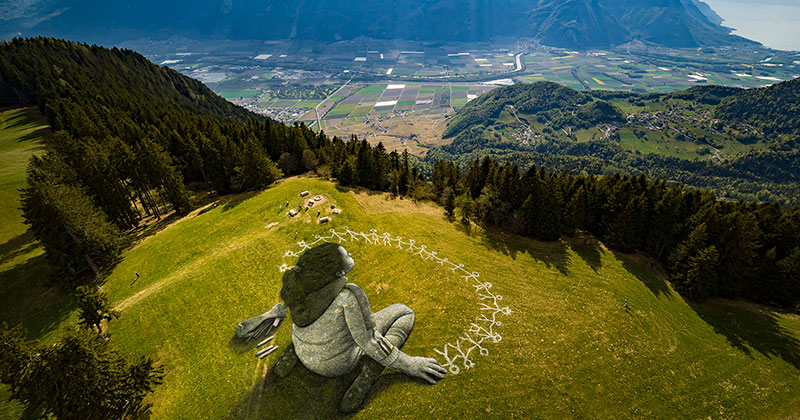 Massive Biodegradable Artwork of Hope Appears Atop Swiss Hillside
