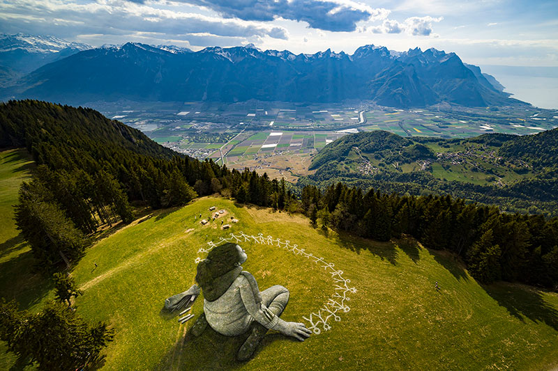 beyond crisis by saype switzerland land art 5 Massive Biodegradable Artwork of Hope Appears Atop Swiss Hillside