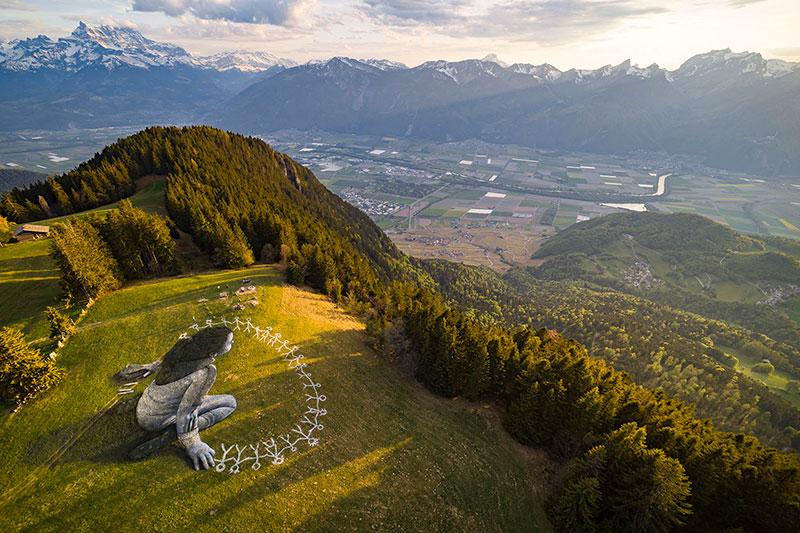 beyond crisis by saype switzerland land art 6 Massive Biodegradable Artwork of Hope Appears Atop Swiss Hillside