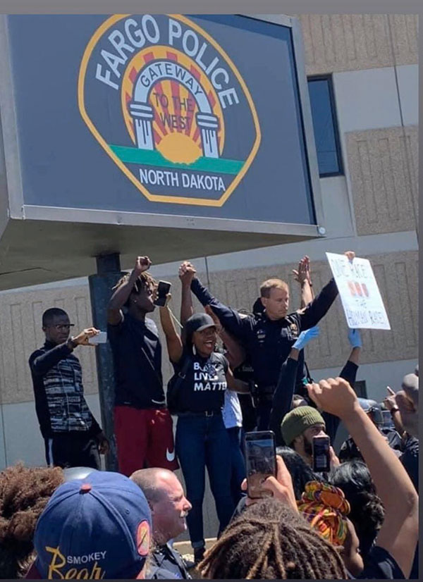 police officers are standing kneeling marching in solidarity 2 Across the Country, a Few Brave Police Officers are Standing in Solidarity