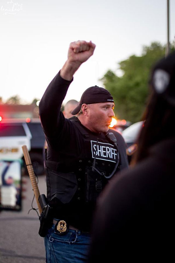 police officers are standing kneeling marching in solidarity 7 Across the Country, a Few Brave Police Officers are Standing in Solidarity