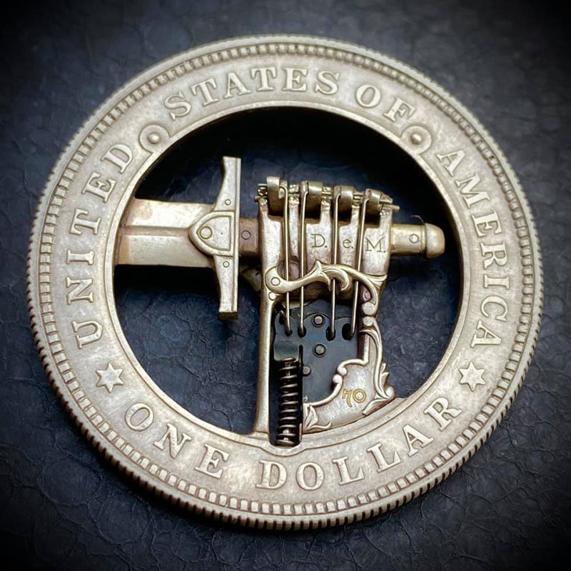 hand gripping sword coin by roman booteen 3 This Modified Silver Dollar has a Secret Button for Clasping the Sword