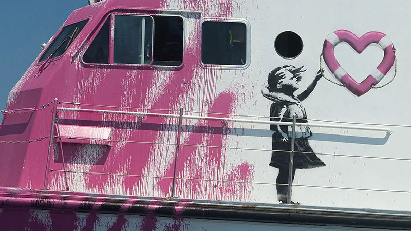 banksy rescue boat 1 Banksy Uses Art Sales to Fund High Speed Lifeboat and Rescue Refugees Stranded at Sea