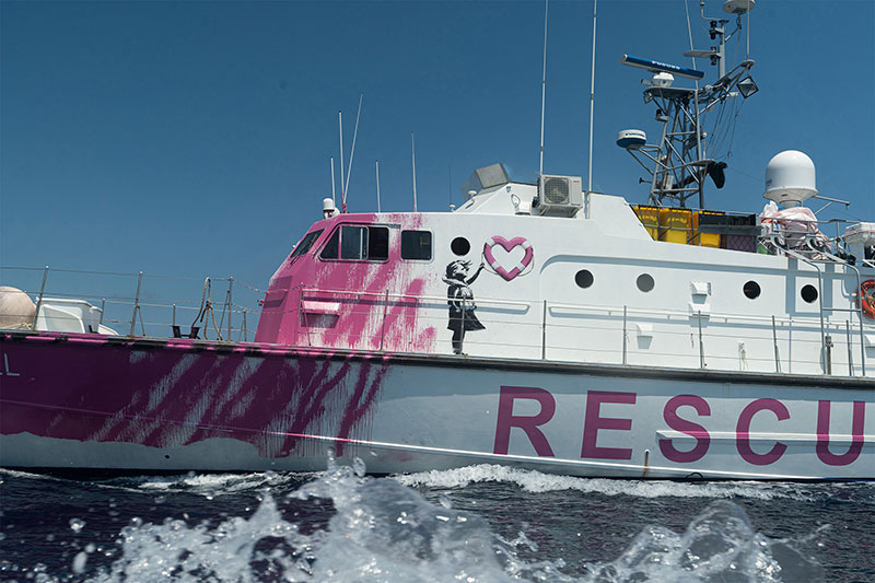 banksy rescue boat 3 Banksy Uses Art Sales to Fund High Speed Lifeboat and Rescue Refugees Stranded at Sea