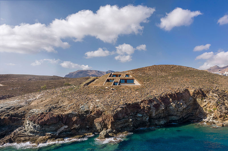 house built into cliff n caved by mold architects 1 Check Out this Ambitious House Built Into a Cliffside in Greece