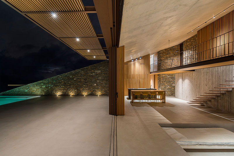house built into cliff n caved by mold architects 11 Check Out this Ambitious House Built Into a Cliffside in Greece