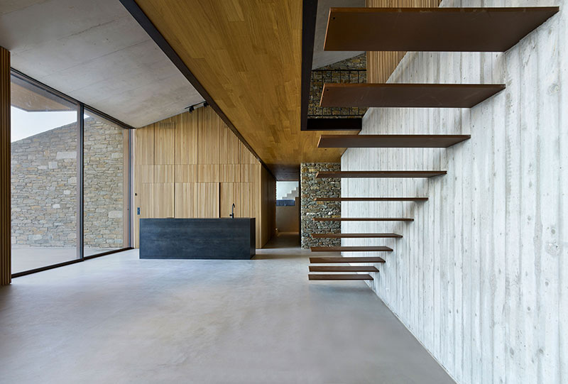 house built into cliff n caved by mold architects 17 Check Out this Ambitious House Built Into a Cliffside in Greece