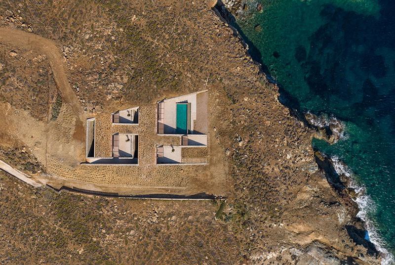 house built into cliff n caved by mold architects 2 Check Out this Ambitious House Built Into a Cliffside in Greece