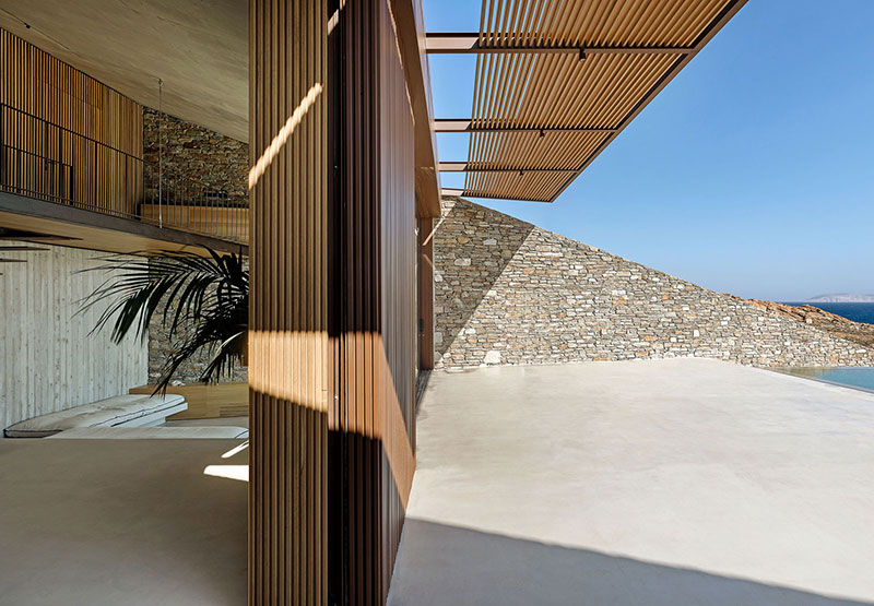 house built into cliff n caved by mold architects 21 Check Out this Ambitious House Built Into a Cliffside in Greece