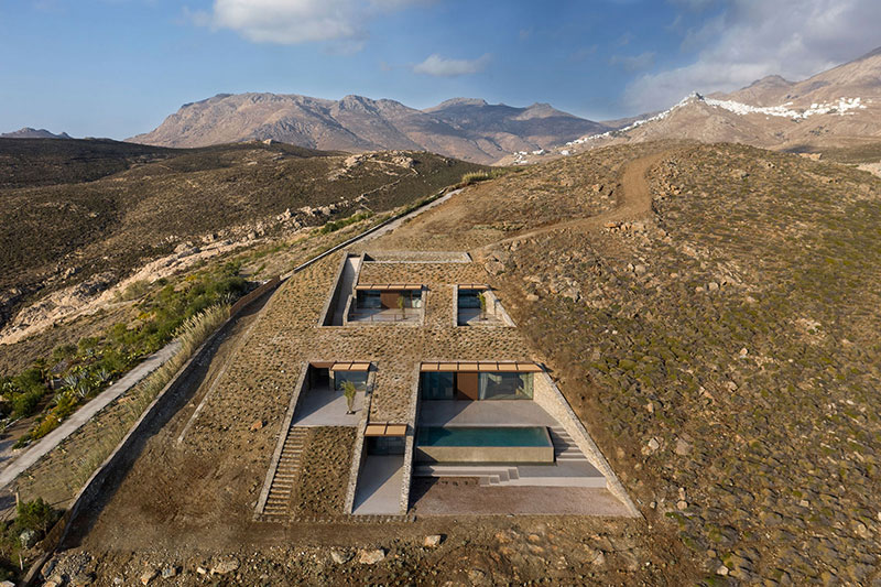 house built into cliff n caved by mold architects 3 Check Out this Ambitious House Built Into a Cliffside in Greece