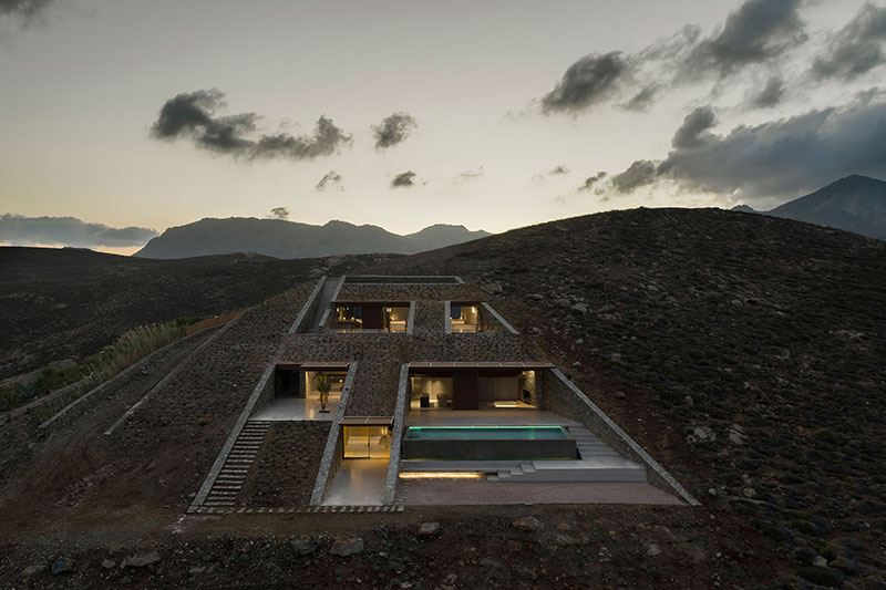house built into cliff n caved by mold architects 8 Check Out this Ambitious House Built Into a Cliffside in Greece