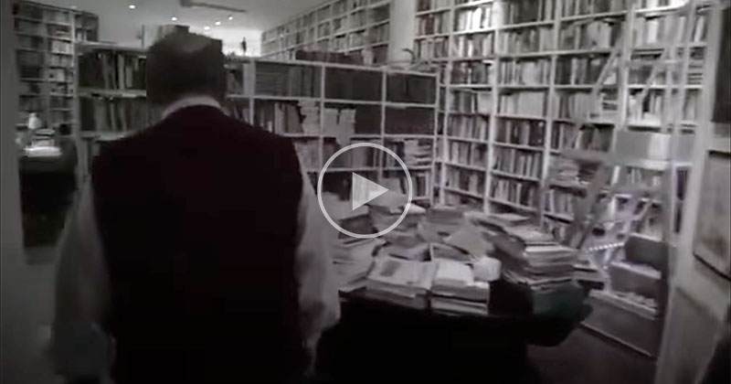 Umberto Eco Looking for a Book in His Massive Library