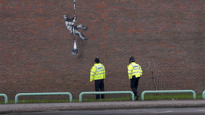 banksy bob ross prison escape street art oscar wilde reading uk 7 Banksy Channels His Inner Bob Ross in Oscar Wilde Prison Escape Artwork