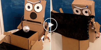 This Cardboard Robot Magician is Breaking My Mind