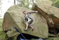 Guy in Tweed Suit Channels His Inner Goat to Climb Boulders with No Hands