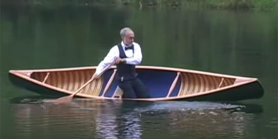 If You Need a Lift, Watch this Gentleman in a Tux Freestyle Canoe to Lady in Red
