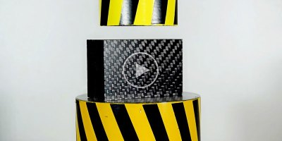 100-Ton Hydraulic Press vs Carbon Fiber, What Do You Think Happens?